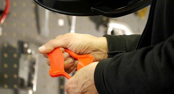 engineer stretches liquid injection molded part